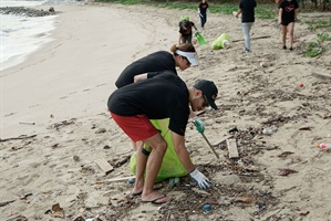 Cleaning the beach at East Coast Park